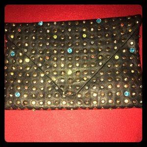 Black leather color stone clutch handbag
